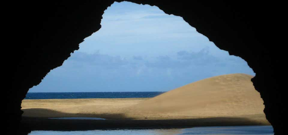 Mindfulness. Kauai beach from cave.